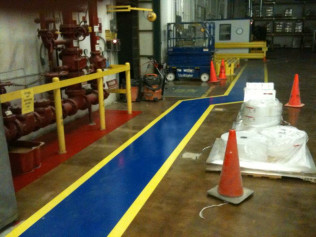 Stained Concrete with Blue & Yellow Epoxy Walkways